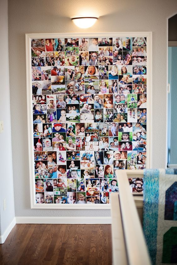 "Bender Photo Collage - I used a 4' x 6' canvas with 12""x 14"" blocks of 4x6""photos. Think quilt blocks. Glue pictures on with Elmers glue leaving a small border between. I nailed (every 12 inches or so)the canvas to wall behind random pictures to keep it smooth. We bought ""primed"" molding to frame it and nailed to wall. Paint trim to match woodwork. This has been up 18 months and still smooth.:"