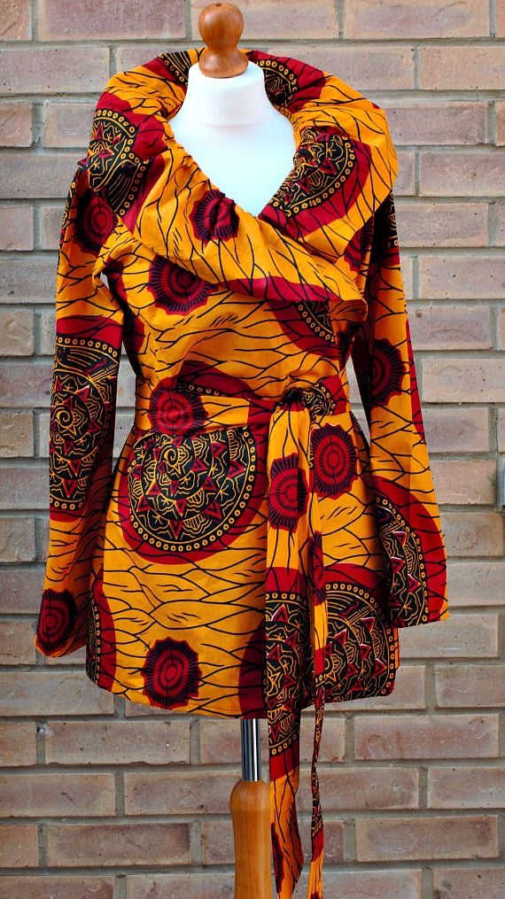 A vibrant African dress in rich golden yellow, red and black print. African…