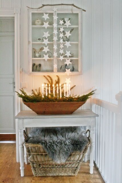 The candlelit wood box is a lovely simple statement, especially for rooms without a fireplace.