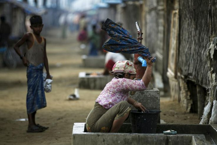 A Rohingya Muslim woman washes clothes at a refugee camp outside Sittwe, Myanmar May 21, 2015. As word spread that the ships were parked close to Myanmar shores, Maung Maung Soe, the camp leader, gathered money from the community to pay off the smugglers. That allowed Roshida and about 30 other people to return. REUTERS/Soe Zeya Tun