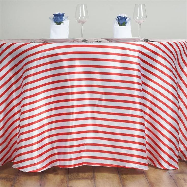 """120"""" Stripe Wholesale SATIN Banquet Linen Wedding Party Restaurant Tablecloth - White/Red /  The fascination for stripes has never faded in the course of history; in fact it has embraced the contemporary trends of fashion industry. The width of line can be minimized or maximized according to the taste of the customer as well as the demand of the product. Well! We love them wide, and we love them thin. So, why settle for plain when you can stand out with the amazing stripy pattern? To make…"""
