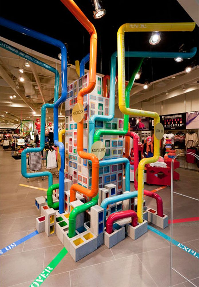 Creative colorful fun use of industrial materials for store display pipes and cmu blocks