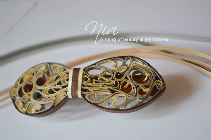 Quilled hair clip.
