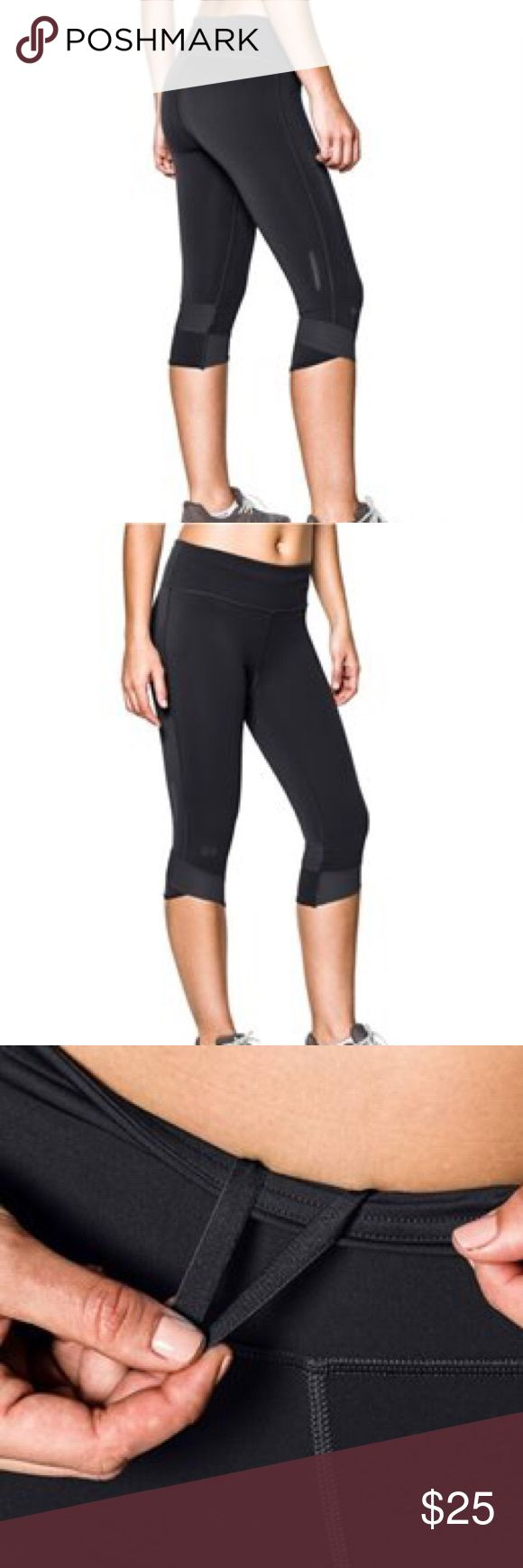Under Armour Fly By Compression Capri Step up your game with the Under Armour® Women's Fly-By Compression Capris. These fitted capris feature UA compression technology for increased muscle power and reduced recovery time. 360° Reflectivity keeps you visible in low-light conditions, while an elastic waistband promotes a secure fit for those long training sessions. A brushed, matte finish gives you a clean, athletic look so you can show your sporty side in these UA capris. Gently used! Lots of…
