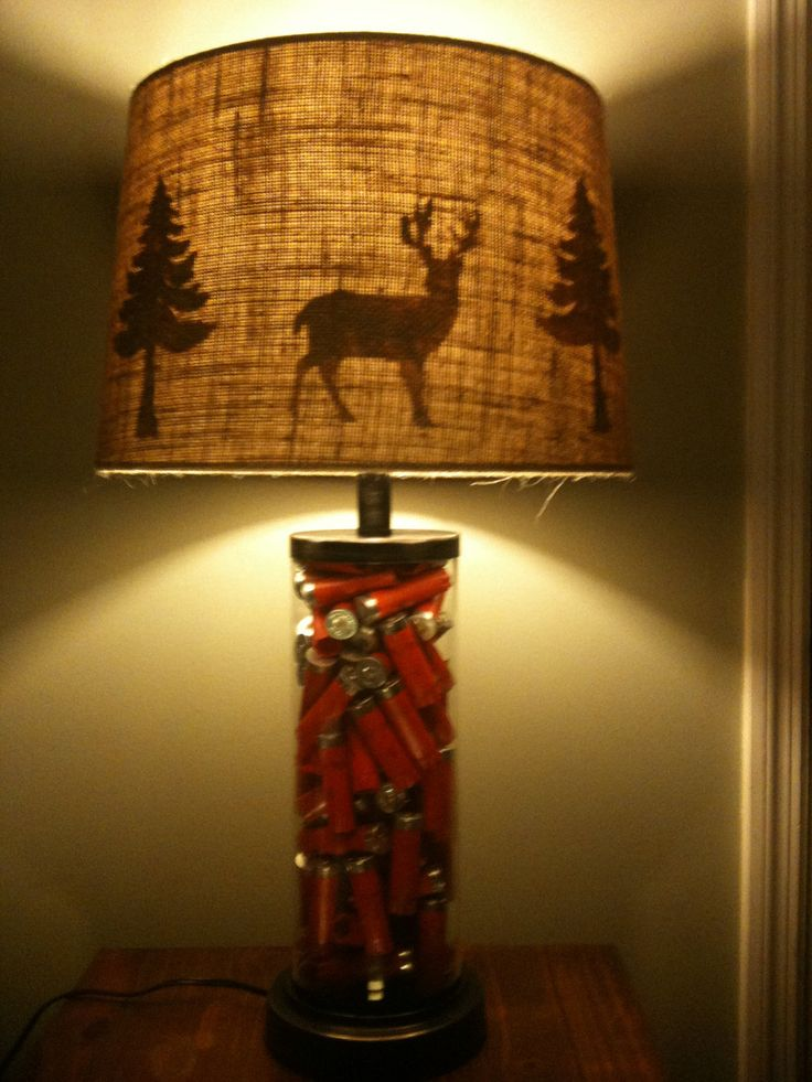Make a shade of pictures...Hunters deer lamp with shotgun shells. $100.00, via Etsy.