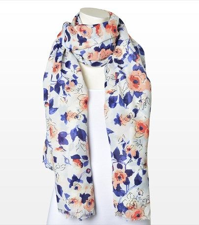 Finish up your look with this scarf featuring a gorgeous floral pattern.