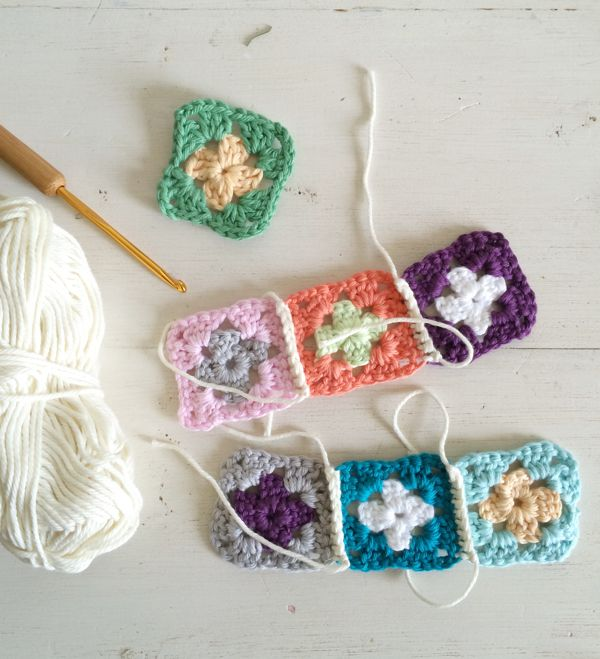 This photo shows the backside of the granny squares connected with a single crochet stitch.