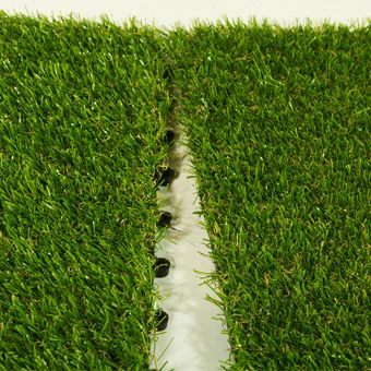 Interlocking artificial grass tiles bring fun to any location indoors or out!  Soft and comfortable, the raised tray allows for excellent drainage.  www.greatmats.com #artificialgrassturftile #artificialturf #grassturftile