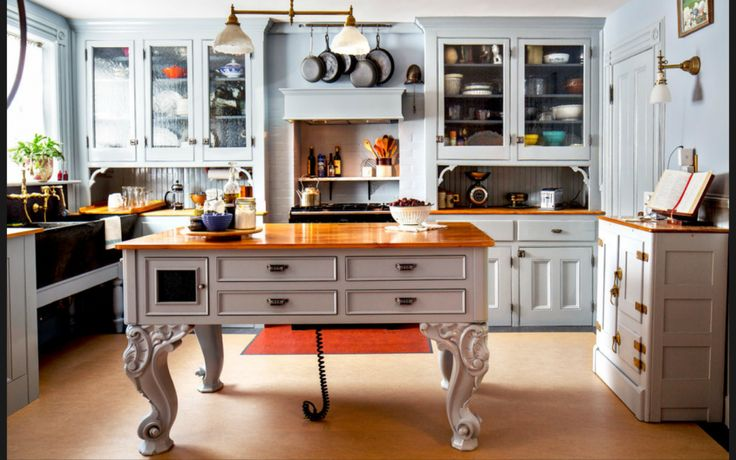 Kitchen. Classic Victorian White Safe Kitchen Design with Unique Kitchen Island that have Beautiful Carving Legs Style complete with the Drawer Space and Traditional Pendant Lamps that have Two White Shades also Functional Wall Mounted Cabinet Ideas. Awesome Collections From Safe Kitchen Designs