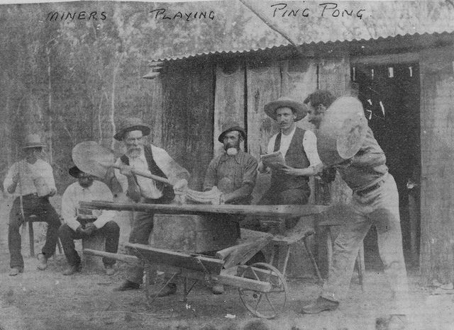 Miners playing ping pong with shovel and panning tin, Queensland, c. 1890