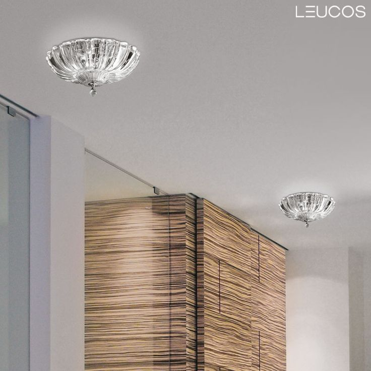 Pascale‬ design by Design Lab for Leucos. Pascale's design alternates sinuous lines with precise grooves which increase the ceiling lamp's depth.