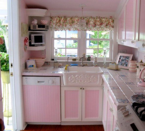 Oh!  I just love this little pink kitchen.  Look at that sink!!