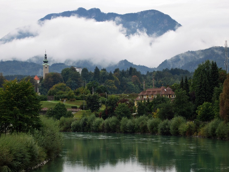"""Sleepy"" Drava River meandering through Villach, South Austria oiginating in the Italian Alps. Drava traverses 725 km through four countries before joining Danube in Croatia."