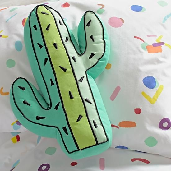 Shop a wild and wonderful selection of throw pillows from The Land of Nod and add the cherry on top to your kids' bedding.