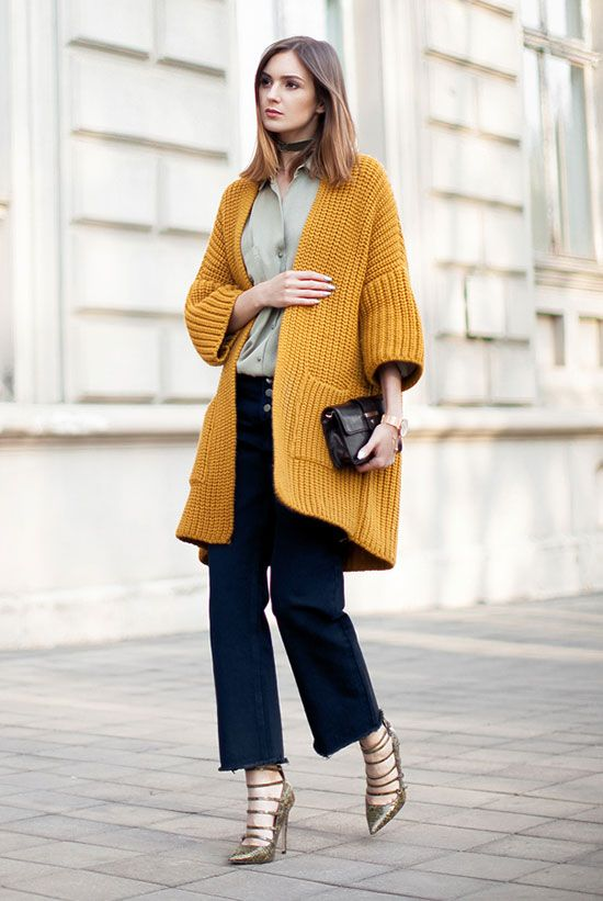 fall outfit, casual outfit, fall work outfit, fall office outfit, street chic style, fall layers - mustard chunky cardigan, yellow chunky cardigan, yellow oversized cardigan, olive shirt, denim culottes, olive heels, black clutch