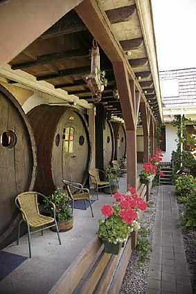Wine barrel hotel (2) - Located in Stavoren, a very old port in northern Holland this hotel is perfect for wine lover's. The rooms where you sleep are in 15,000 litre wine barrels. There are four of them, each created from Swiss drums that used to contain Beaujolais wine from the French chateau area.