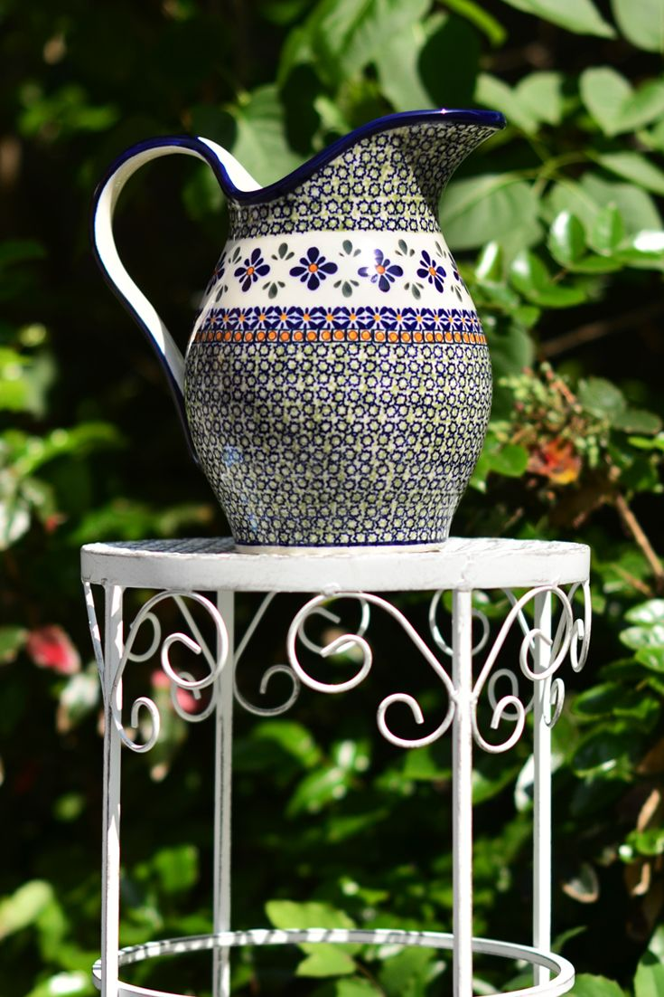 Pitcher with handle. Can be used to serve water, cold drinks and juice. Made of natural ceramic clays, hand formed and hand decorated by Bolesławiec artist.