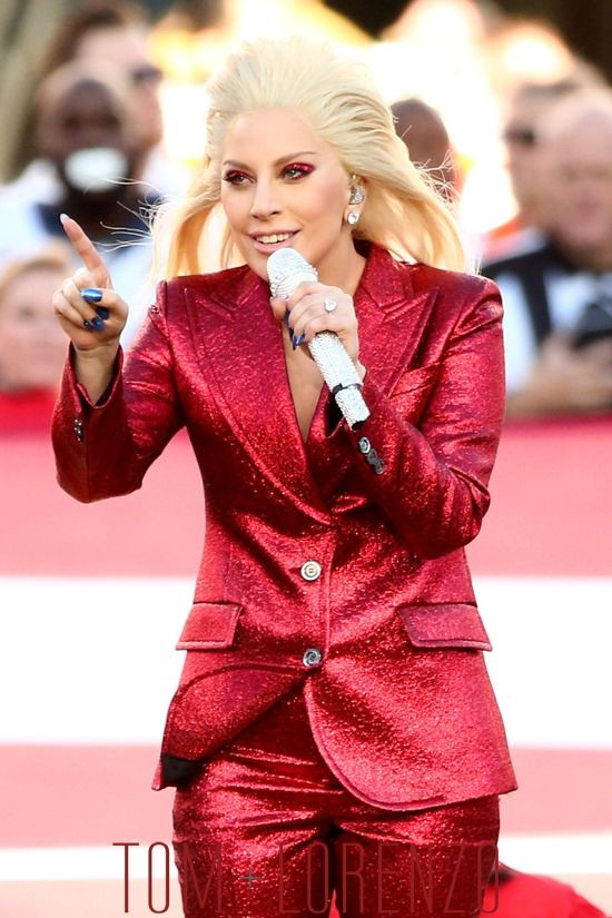Lady Gaga sang the National Anthem at-Superbowl 50 (2016) wearing a Gucci suit.