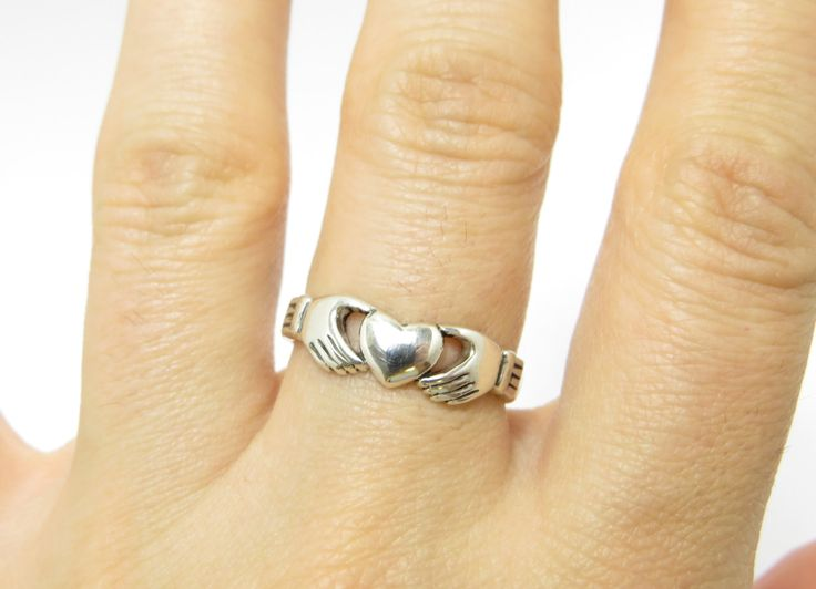 Claddagh Ring is a traditional Irish ring designed to embody all the notions of Love, Loyalty and Friendship. Often Claddagh rings are used as wedding bands and friendship charm rings. The best gift on St. Valentines Day. Metal: oxidized sterling silver 925. Unisex. Shipped in a gift