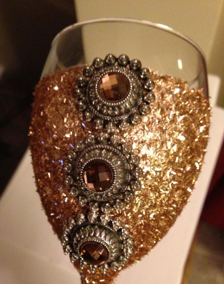 champagne colored wine glass with jeweled decor