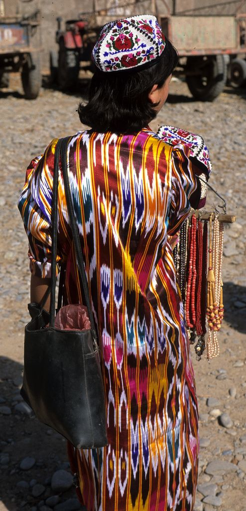 Uzbekistan, Khiva, Girl in Ikat Kurta and Embroidered Duppi