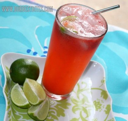 Strawberry Limeade.....delicious and so easy to make!  A squeeze of lime, strawberry puree and Sprite!