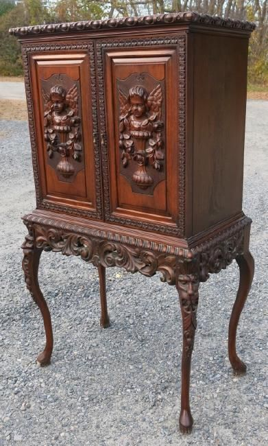 ORNATELY CARVED EUROPEAN CABINET : Lot 219