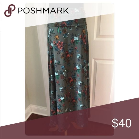 "Lularoe Maxi skirt Work once. Washed per LLR standards. ""Slinky"" material. So comfy!! LuLaRoe Skirts Maxi"