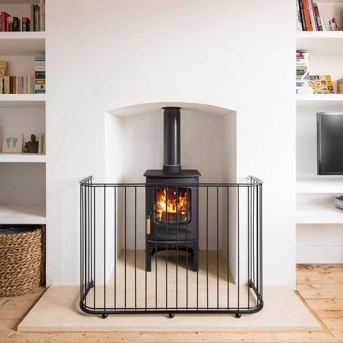 Large contemporary, designer fireguard, carefully designed to keep pets, children and unsteady adults(!) safe. Can be made to measure for protruding wood burning stoves> http://www.garden-requisites.co.uk/products/fireguards/