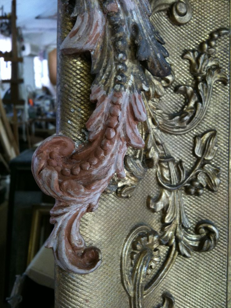 An ornate swept frame I'm currently restoring. Here is a section I've replaced with a moulding putty before gessoing and gilding.