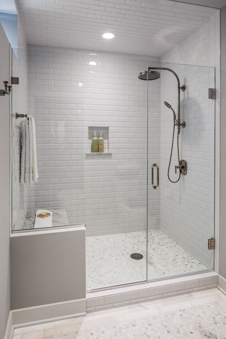 The guest bath had a shower area that was dated and confining. A new frameless glass shower is roomier and allows in natural light. A built-in bench, marble floors and glazed subway tile walls and ceiling finish off this suite.