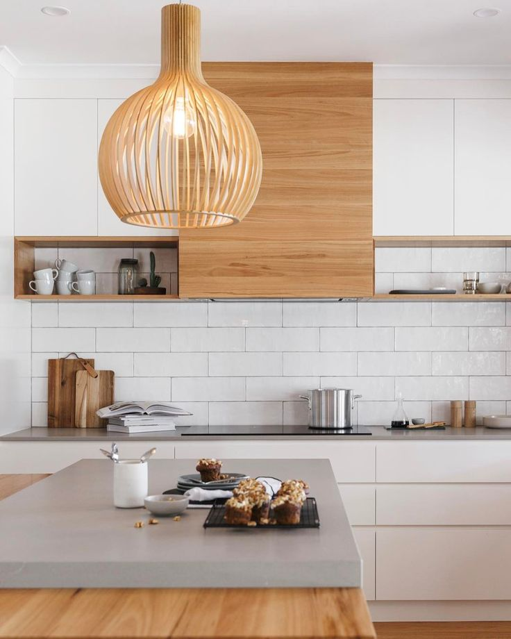 The perfect balance between fresh matt white cabinetry timber finishes & the industrial look & feel of Caesarstone Raw Concrete @space_craft_joinery we are loving the pure simplicity of this space! @jvdkphoto