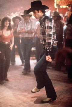 Urban Cowboy, 1980.  Debra Winger and John Travolta.  Travolta was riding the wave of Saturday Night Fever popularity, and was everywhere.  Winger was up and coming.   Launched a Western and line dancing trend.