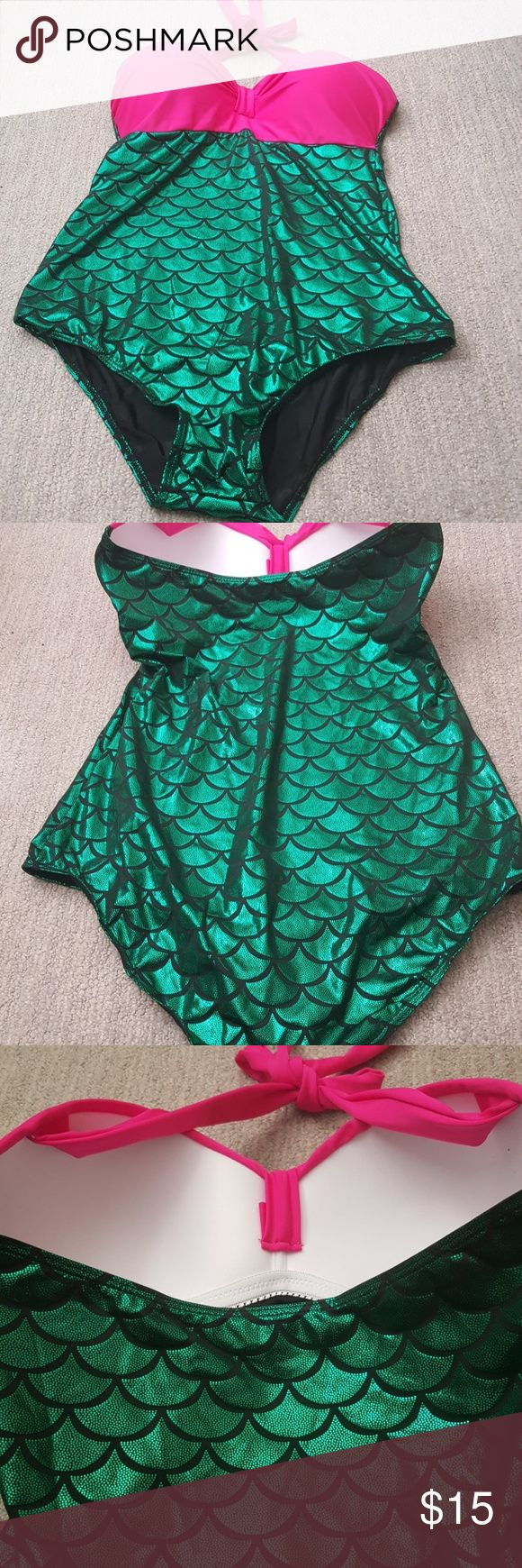 Mermaid bathing suit This item was bought from amazon. Its a mermaid style bathing suit, has a halter tie top. It is a one peice suit, still has the protection cover on crotch area. I tried this on over shape wear, its to small for me. Inside is lined black fabric, has a bright green mermaid scale pattern all over bottom. I have never worn this to the beach or pool its a clean bathing suit. Swim One Pieces