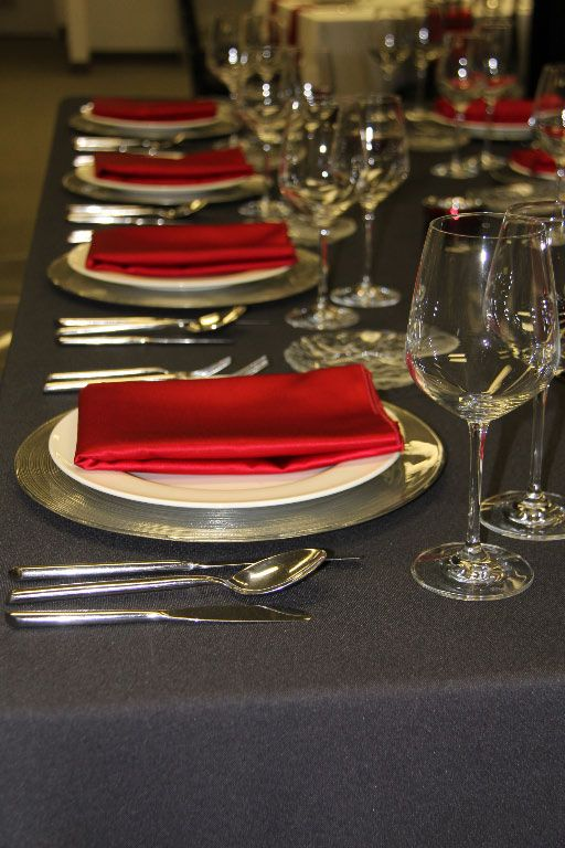 Grey Flannel Table Linen, Silver Swirl Charger, Milano Flatware, Adriana Dinner Plate, Dolce Crystal Glassware & Red Satin Napkin | Chair-man Mills  Photography by: Debbie Kriz