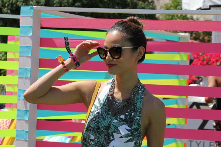 Pin for Later: Spring Beauty Inspiration Straight From the California Desert Coachella Beauty Street Style 2015 Jamie Chung beat the heat with a topknot and matte red lipstick.