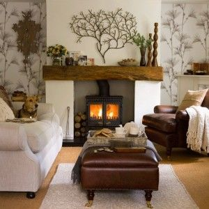 Wood-burning stove in fireplace. Knarled wooden mantle. Tree silhouette.