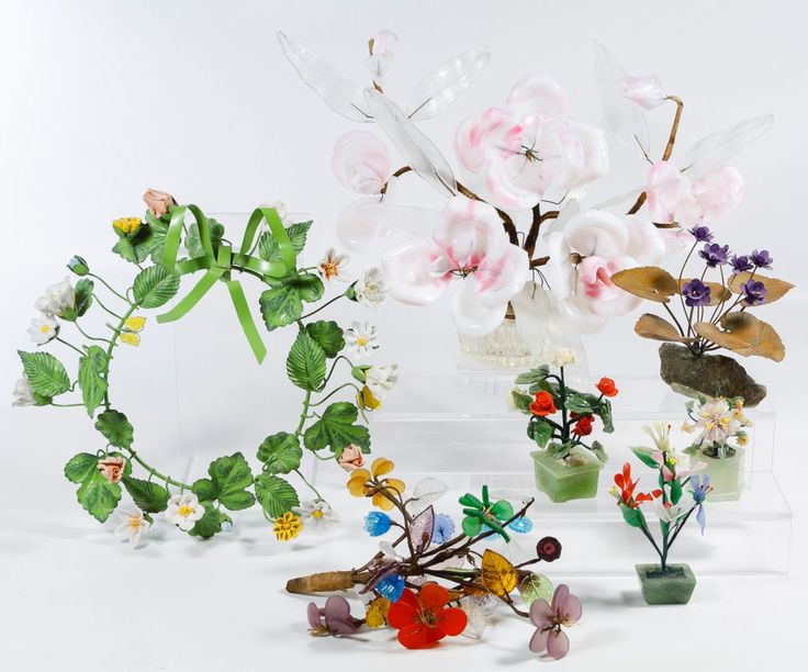 Lot 614: Glass and Metal Floral Arrangements; Including a large pink and white glass petal floral arrangement, an Asian jadeite jade small arrangement, a wire floral wreath, a Neiman Marcus underside decal on a wire violet arrangement and a pair of plastic Asian floral bouquets