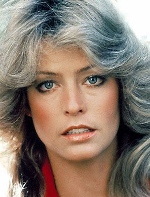 Farrah Fawcett- This is a really iconic 70s look. A sheer foundation with natural contouring a blush.