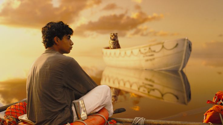 The main character and the lion together. The main character is sitting on wreckage looking out to the sea.