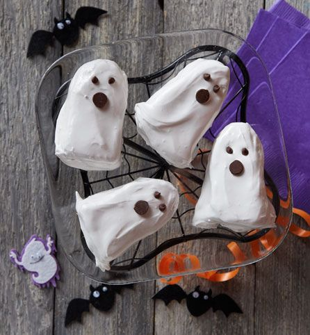 Adorably spooky, these little ghost cakes made from white cake mix and topped with a marshmallow frosting and mini chocolate chip eyes are a fun Halloween activity for kids of all ages!