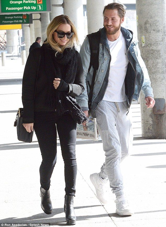 Love is in the air: Margot Robbie couldn't stop smiling as she arrived to JFK airport with her boyfriend, Tom Ackerley in New York on Saturday