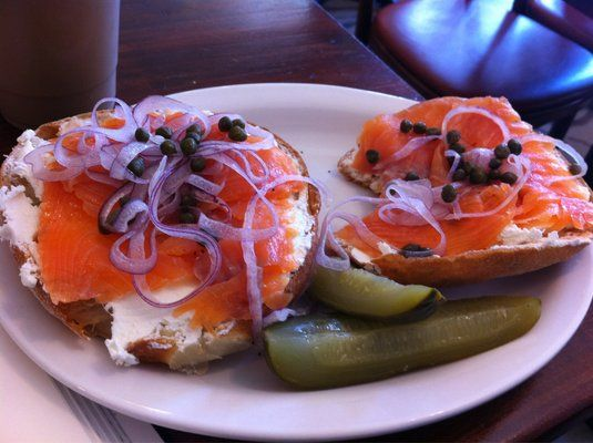 Open face bialy with cream cheese, lox, capers and onions.   Jewish ...