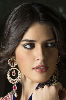 Earrings in gold finish with kundan and ruby pink stone