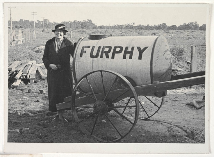 Australian author Stella Miles Franklin standing next to a Furphy water truck. Because these trucks went everywhere in the Australian bush they became synonymous with the spread of a tall story. Find more detailed information about this photograph: http://acms.sl.nsw.gov.au/item/itemDetailPaged.aspx?itemID=431966 From the collection of the State Library of New South Wales http://www.sl.nsw.gov.au
