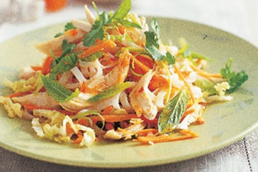 Vietnamese chicken noodle salad - 3 small single chicken breast fillets, 150g rice stick noodles, 1 T rice vinegar, 2 T fresh lime juice, 1 T sweet chilli sauce, 2 t fish sauce, 2 t peanut oil, 2 cups finely shredded Chinese cabbage, 2 carrots, 8 green shallots, 1/4 cup loosely packed fresh mint leaves, 1/4 cup firmly packed fresh coriander leaves