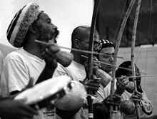 Music is one of the most instantly recognizable elements of Brazilian culture. Many different genres and styles have emerged in Brazil, such as samba, choro, bossa nova, MPB, frevo, forró, maracatu, sertanejo, brega and axé. In the picture 3 Berimbaus and 1 pandeiro being played