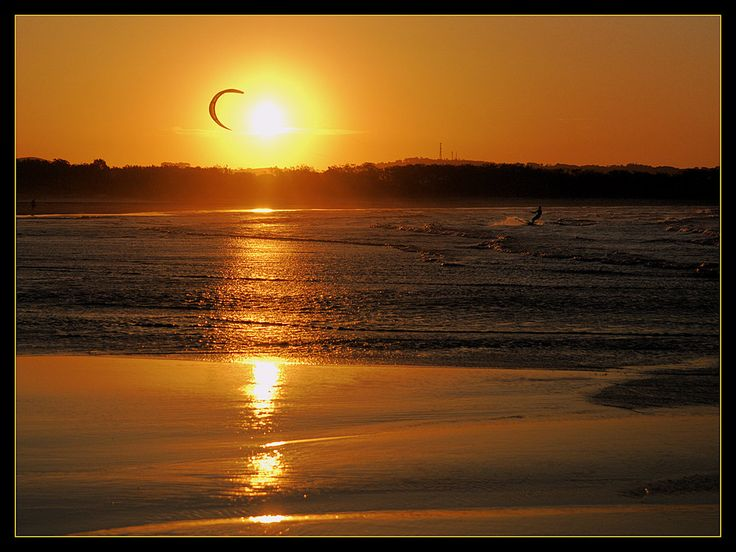 Kite surfing at sunset, Byron Bay, Australia    by wildplaces
