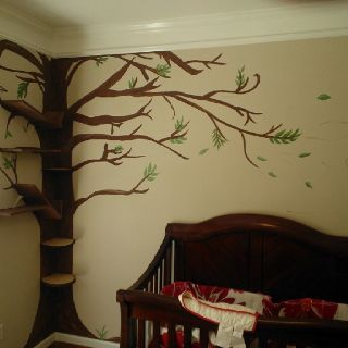 Whimsical tree mural with windblown leaves over our baby's crib. Our friend painted it onto our wall with water based paints. My amazing husband added tree trunk slices (hobby lobby) for corner shelves and then shelves on the wall (left) that blend into branches from the front.