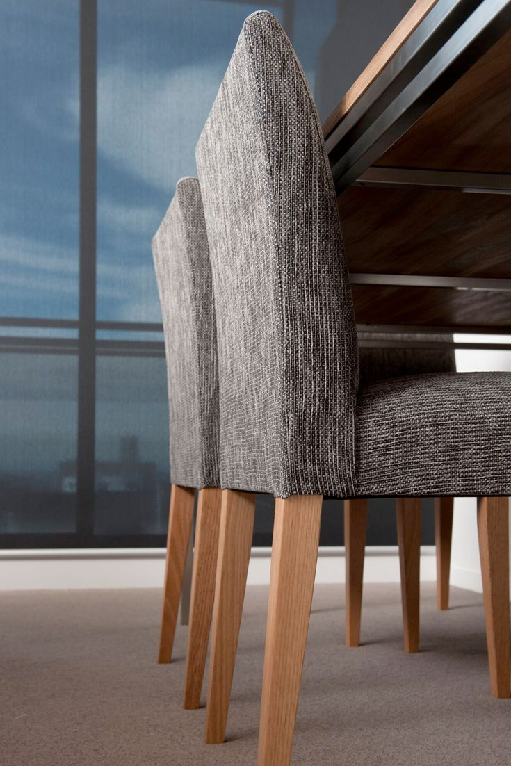 Emme Designs custom dining chair in a charcoal fabric.